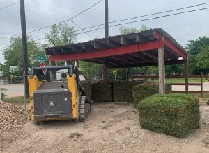 image of grass being loaded for customers