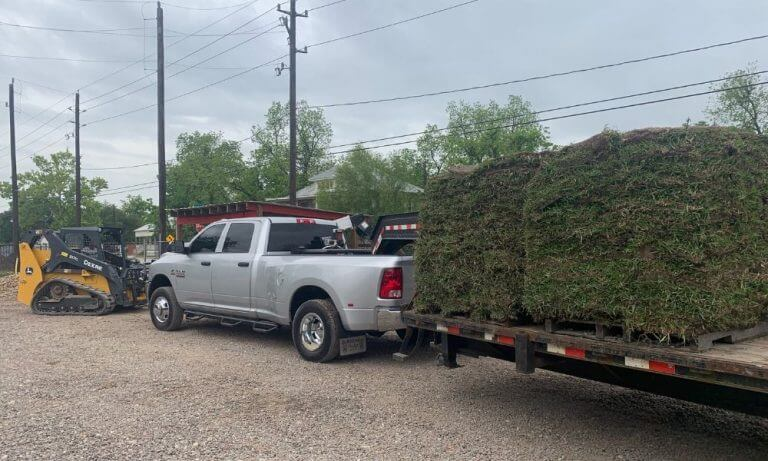 picture of grass pallets loaded on delivery trailer