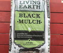 image of black mulch by the bag